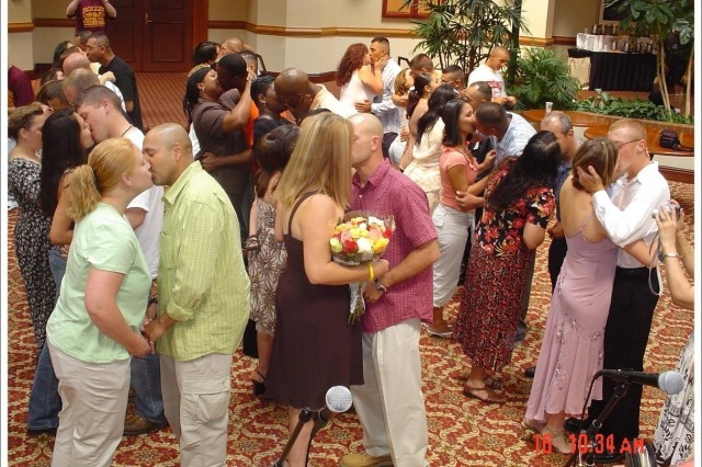 Army couples seal their commitment with a kiss following a marriage renewal ceremony at a Strong Bonds retreat. Programs like Strong Bonds have a significant impact on military divorce statistics.