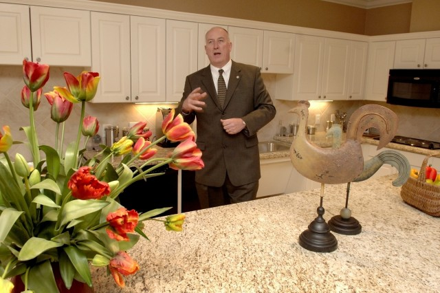 Dave Coker, president of the Fisher House Foundation, shows off the communal kitchen at one of the new 16,800 square foot Fisher House facilities adjacent to the Center for the Intrepid.  Each Fisher House can accommodate 21 families.