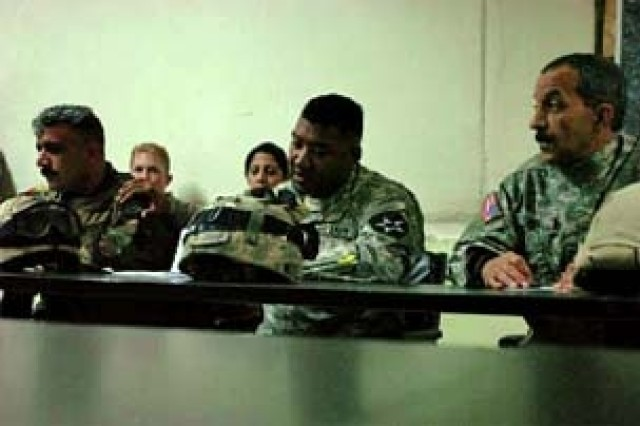 Lt. Col. Avanulas Smiley (center), battalion commander for 1st Battalion, 23rd Infantry Regiment, 3rd Stryker Brigade Combat Team, 2nd Infantry Division addresses the local Iraqi leaders of the Baghdad's Karkh District during a security council meeting, Jan. 23.