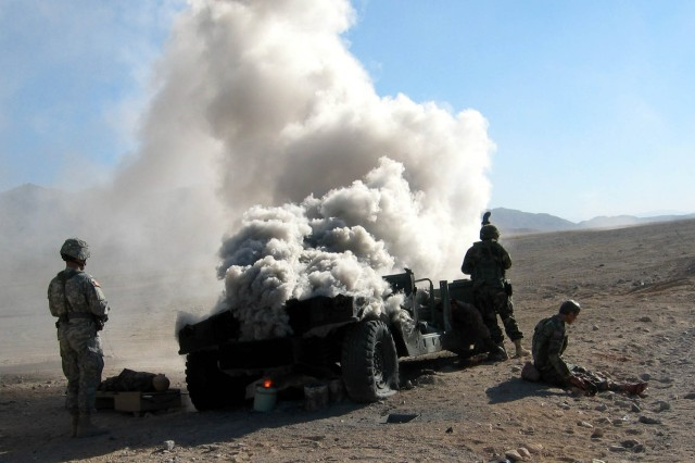 Medics from the 3rd Infantry Division's 2nd Battalion, 69th Armor Regiment, encounter a vehicle-borne IED as they train at the National Training Center at Fort Irwin, Calif., in preparation for their upcoming deployment to Iraq.