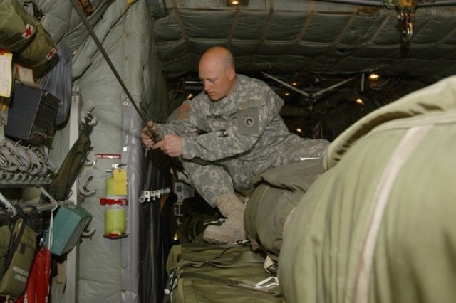 Staff Sgt. Kevin Brown secures supplies for a heavy drop.