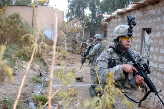 The Soldiers search homes for weapons.