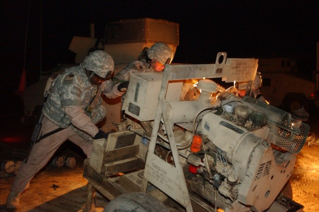 Soldiers from the 115th Brigade Support Battalion, 1st Cavalry Division, offload a water pump at Water Access Point 2 in Mushada, Iraq. This water access point supplies Baghdad with 67 percent of its water.