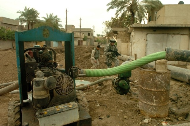 Capt. Marc Motyleski, from Brigade Special Troops Battalion, 2nd Brigade Combat Team, 1st Cavalry Division, inspects a sewage pump site in Baghdad.