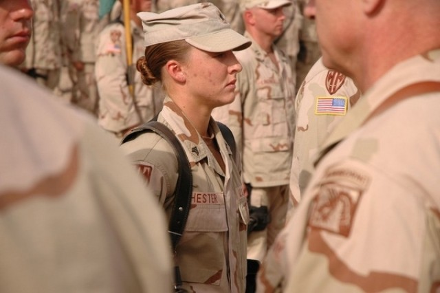 Sgt. Leigh Ann Hester, vehicle commander, 617th Military Police Company, Richmond, Ky., stands at attention before receiving the Silver Star at an awards ceremony at Camp Liberty, Iraq, June 16, 2005. Hester will be honored Feb. 3 at Fort Lee, Va., during the opening of the Army Women's Museum's new exhibit recognizing the contributions of women Soldiers during the war on terror.