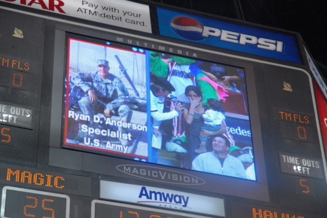 The Jumbo-tron shows the live video call between Florida Guardsman Ryan Anderson and his wife Alma during the 'Seats for Soldiers' night game hosted by the Orlando Magic at the Amway Arena.