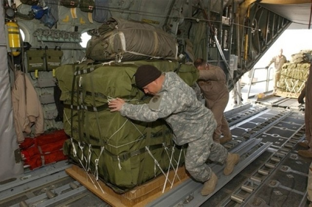 Parachute riggers move supplies onto an aircraft. Twenty riggers are assigned to the rigger section of the Combined Joint Task Force at the Bagram Airfield, Afghanistan. The Soldiers are from several Fort Campbell, Ky., and Fort Bragg, N.C., units. U.S.