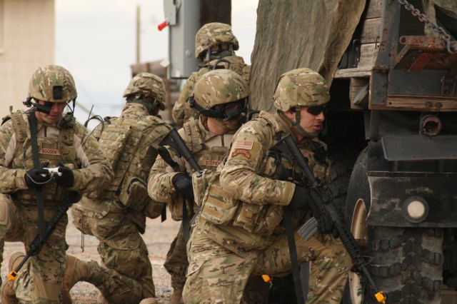 A Soldier (left) from the Future Combat Systems, Evaluation Brigade Combat Team, views his screen for unforeseen obstacles during an exercise and live demonstration Feb. 1 at Oro Grande Range, Fort Bliss, Texas.