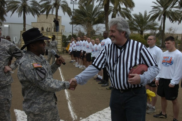 CBS NFL Analyst Randy Cross shakes hands with the commander of the 2nd Brigade Combat Team, 1st Cavalry Division, Col. Bryan Roberts, before beginning the inaugural Baghdad Bowl at Forward Operating Base Prosperity Feb. 3.
