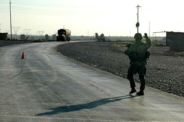 A paratrooper from Company B, 1st Battalion, 505th Parachute Infantry Regiment, 82nd Airborne Division, stops an oil tanker from entering a checkpoint at the Bayji Oil Refinery in Iraq, Nov 12., 2006.