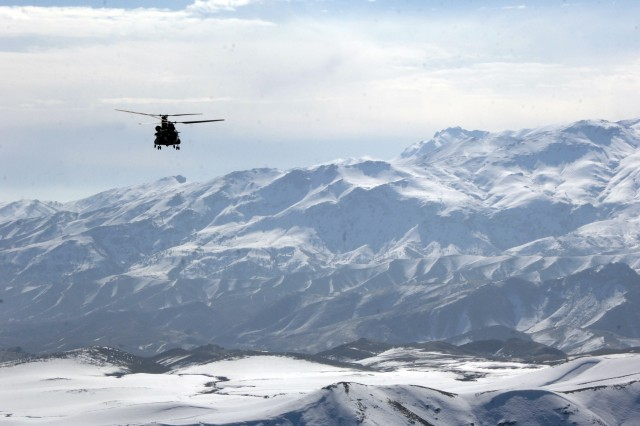 The view from the tailgate of a Chinook is breathtaking and almost relaxing; except for the fact that someone on the ground might try taking a potshot.