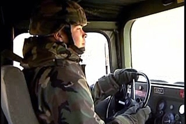 A soldier gets behind the wheel of a HUMVEE for the first time. Incidentally the first time driving a vehicle ever. Drivers course builds his confidence.