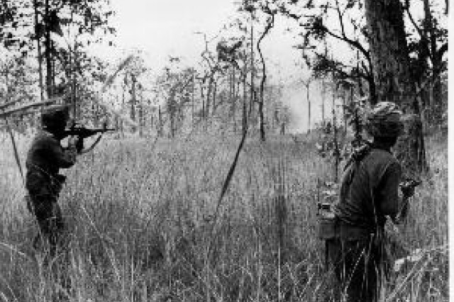 B Co, 2/7th CAV troopers advancing at X-Ray on 16 Nov 65. Artillery explosion in background. Photo by Peter Arnett, Associated Press.