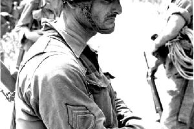 SSG Joes G. Claudio-Robles, A Co 1-7 CAV waits for extraction at end of a long battle, 16 Nov 1965, LZ X-Ray. Photo by Joe Galloway.