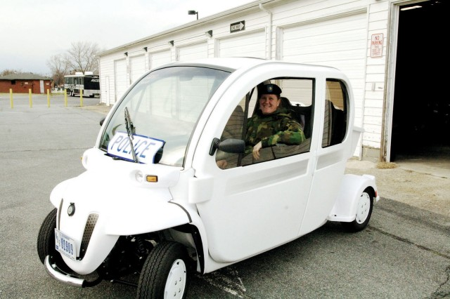 Maj. Heidi Kavanaugh, Fort Monroe Provost Marshal, proudly demonstrates the capabilities of her office's new Neighborhood Electric Vehicle that was delivered last week. The four-seater uses about the same amount of power as a 75-watt light bulb. It can travel up to 35 miles on a full charge.