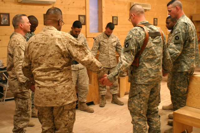 Cmdr. Harry Griffith, the Marine Corps' Regimental Combat Team 2 chaplain, leads servicemembers in prayer at the Camp Ripper chapel in Iraq, Jan. 21.