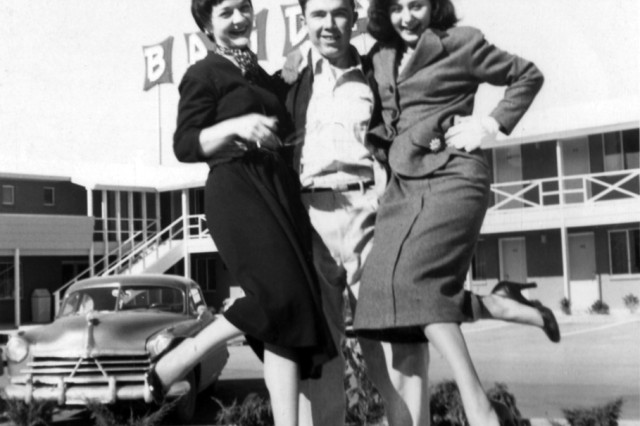Bruce as a new aviator enjoys a laugh lifting two lady friends, circa 1956.