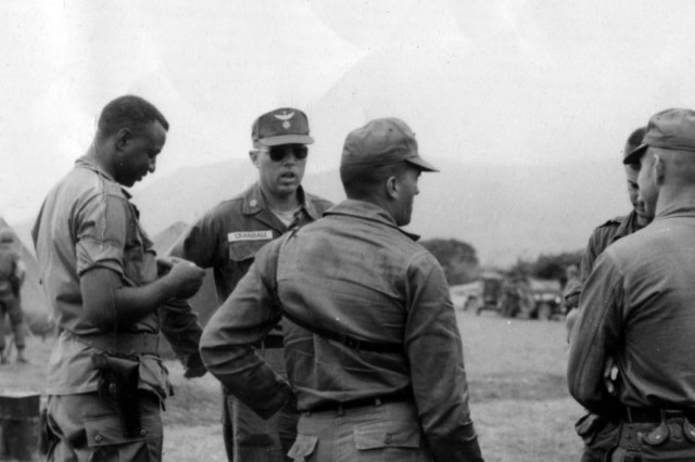Bruce meets with Infantry officers discussing on-going combat activities in Vietnam, 1966.