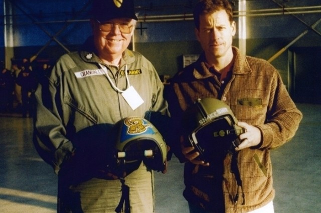 "Bruce with actor Greg Kinnear on the set of ""We Were Soldiers."" Kinnear portrays Bruce's actions at Ia Drang in the film."