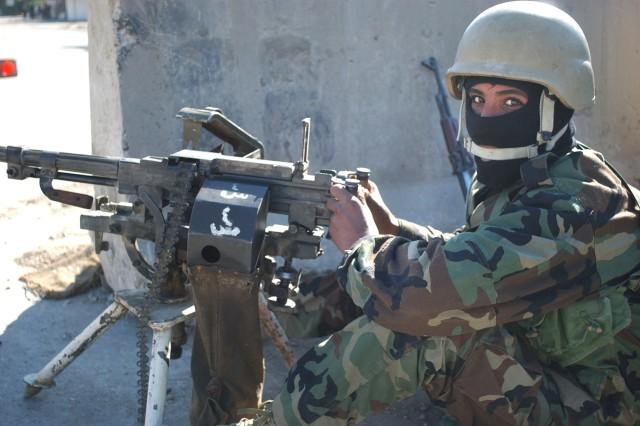 An Iraqi National Policeman provides security at a checkpoint in Saydiyah, Iraq, Jan. 23.
