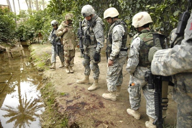 The Soldiers find a trail of blood and follow it.