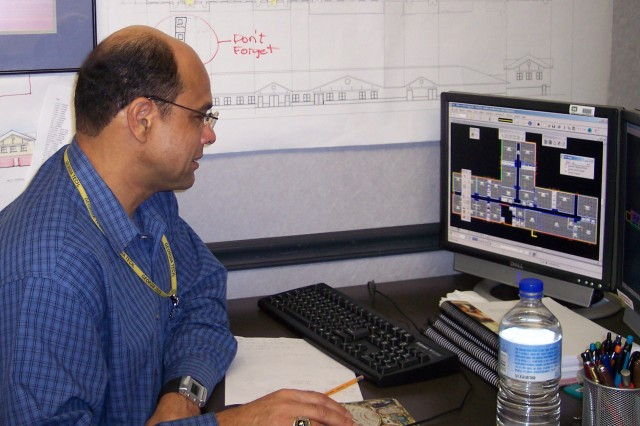 James Dunn, lead architect for the child development center design, learns the various components of the Building Information