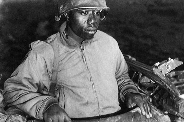 Tank Commander Harvey Woodard assesses terrain near Nancy, France, in November of 1944.
