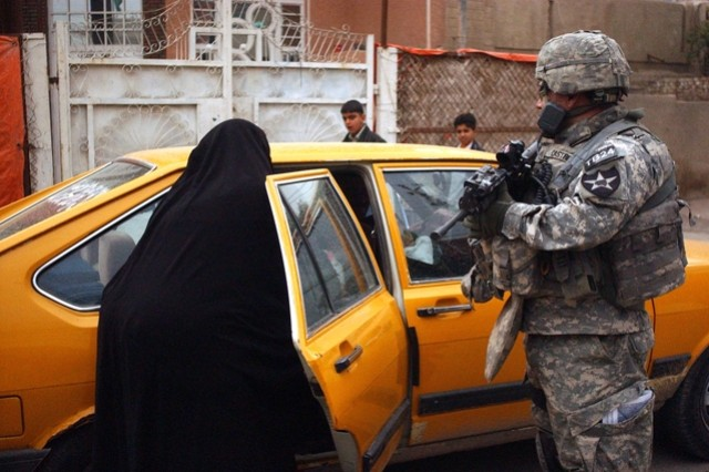 Staff Sgt. George Castro speaks with local residents during the patrol.
