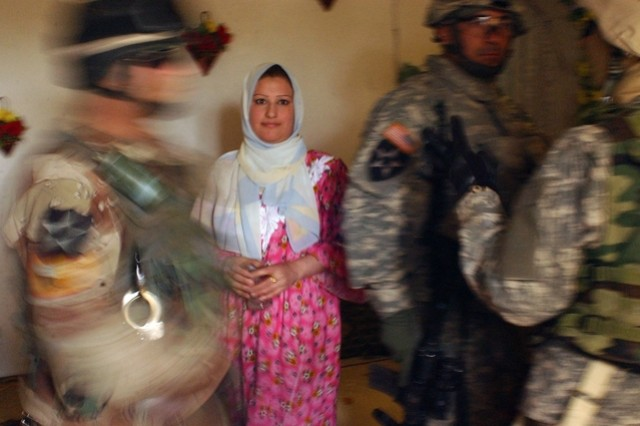 The Soldiers and their Iraqi interpreter search a house.