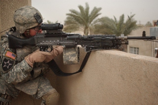 Spc. Kevin Kane provides rooftop security for fellow Soldiers.