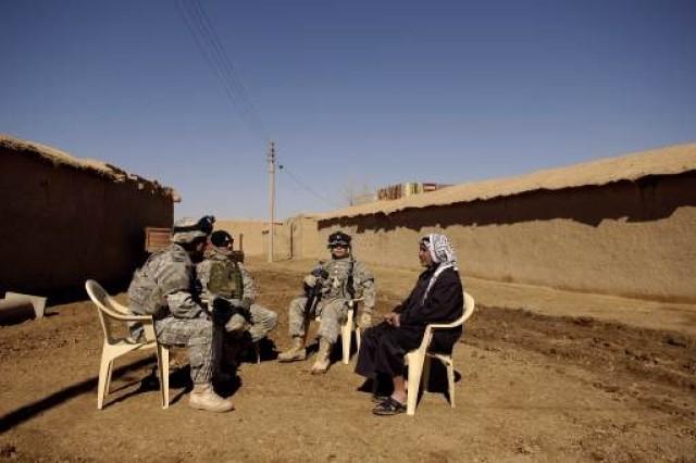The Soldiers meet with village elders.