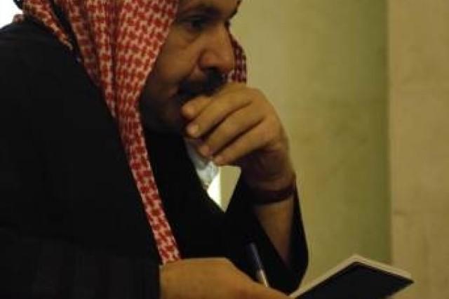 Sheik Alassi Burhan listens to Lt. Col. Drew Meyerowich discuss local town matters.