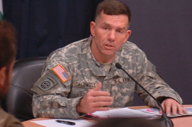 """Maj. Gen. William B. Caldwell IV, Multi-National Forces-Iraq spokesman, holds an operational update briefing at the Combined Press Information Center in the International Zone Wednesday. Photo by Army Sgt. Matthew Roe, 10th Public Affairs Operations Center."""""""