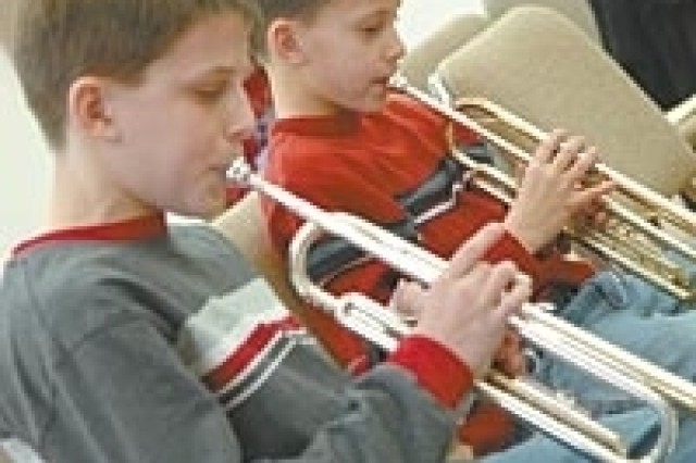 Nicholas and Michael Balducci warm up their trumpets before getting some lessons from the members of the U.S. Army Blues Jazz Ensemble trumpet section at the 392nd Army Band practice room, Saturday.