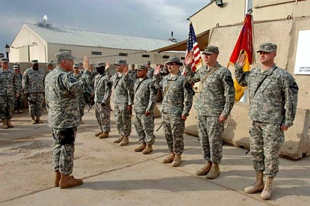 Vice Chief of Staff of the Army Gen. Richard A. Cody re-enlists Soldiers of the 1st Brigade Combat Team during his visit to Camp Taji, Iraq, Feb. 13.