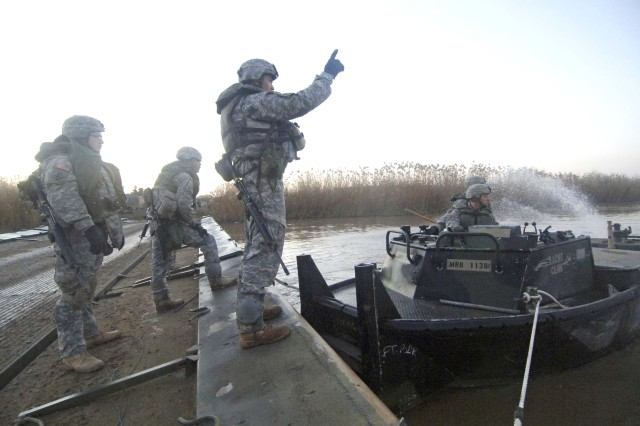The Soldiers move another section of the bridge.
