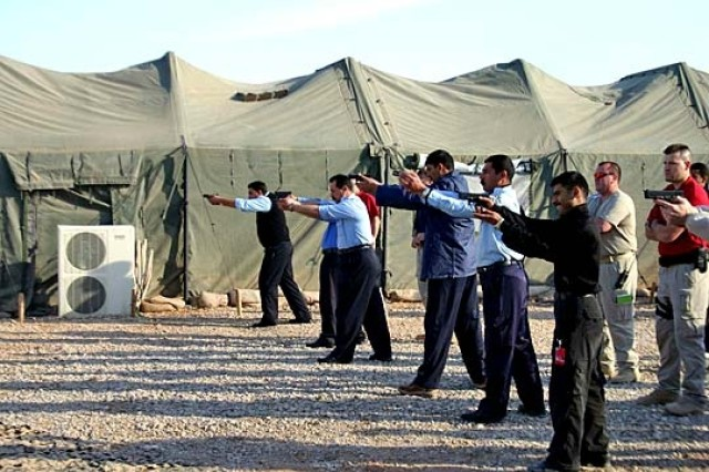 Iraqi Police Train to Lead, Protect