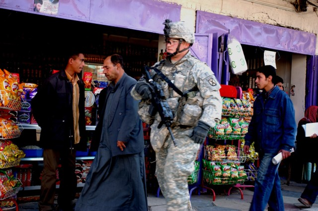 Staff Sgt. David Francis, a personal security detachment squad leader, patrols the streets of Martyrs Market as local nationals buy and sell, Feb. 14.