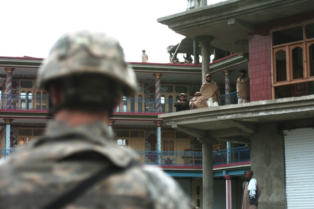 A Soldier helps secure the area during a scheduled meeting between key leaders in Kunar Province.