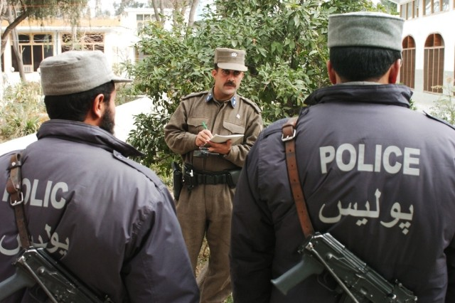 Afghan police officers prepare for a patrol in Asadabad.