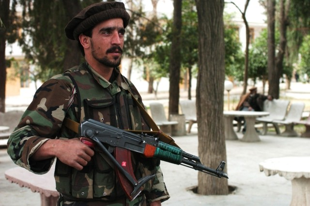 An Afghan Soldier provides security outside the Asadabad government compound.