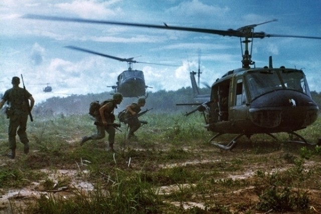 """UH-1D Iroquois helicopters airlift members of the 2nd Battalion, 14th Infantry Regt. From the Fihol Rubber Plantation to a new staging area during """"Operation Wahiawa"""", a search and destroy mission conducted by the 25th Infantry Division, northeast of Cu Chi, Vietnam."""""""
