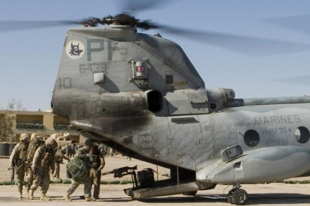 Soldiers from 1st Battalion, 36th Armor Regiment board a Marine Corps CH-46 Sea Knight helicopter departing Camp Hit, Iraq, in the volatile Anbar Province. Insurgents have been targeting Army and Marine helicopters there and elsewhere.