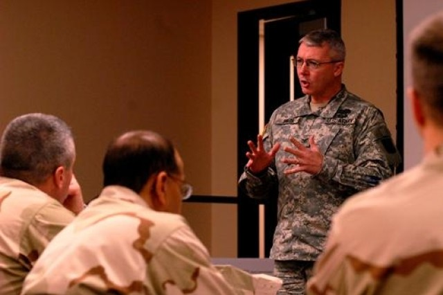 Col. Michael Smith, of the Fort Leavenworth Joint Center for International Security Force Assistance, relates an experience he had in Iraq at the counterinsurgency conference hosted by the COIN Center Feb. 20 at the Battle Command Training Center.