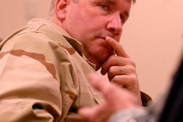 Navy Capt. Andy Kilgore, team chief for the National Command Center military transition team, listens to a counterinsurgency discussion Feb. 20 at the Battle Command Training Center.