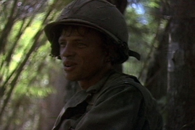 A Soldier of the 1st Battalion, 7th Cavalry, during the fight for LZ X-Ray in the Ia Drang Valley of Vietnam.  Photo extracted from US Army motion picture footage. (Nov 1965)""