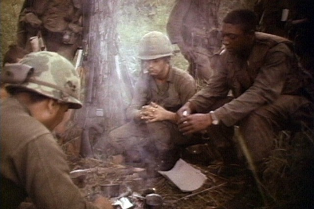 Soldiers of the 1st Battalion, 7th Cavalry, gathered together heating rations during the fight for LZ X-Ray in the Ia Drang Valley of Vietnam.  Photo extracted from US Army motion picture footage. (Nov 1965)""