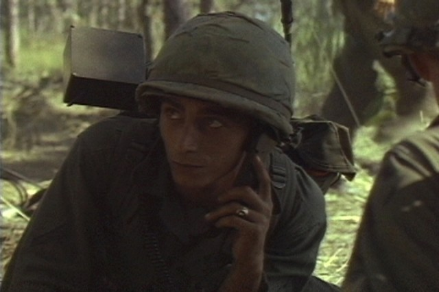A Soldier of the 1st Battalion, 7th Cavalry, on the radio during the fight for LZ X-Ray in the Ia Drang Valley of Vietnam.  Photo extracted from US Army motion picture footage. (Nov 1965)""