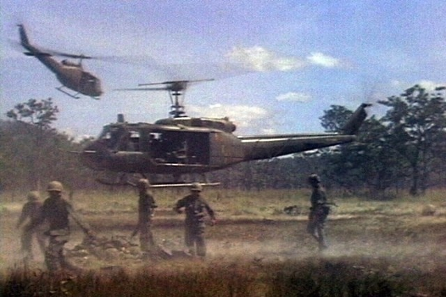 UH-1 aircraft of the 229th Assault Helicopter Battalion, carry wounded 1st Battalion, 7th Cavalry Soldiers away during the fight for LZ X-Ray in the Ia Drang Valley of Vietnam.  Photo extracted from US Army motion picture footage. (Nov 1965)""