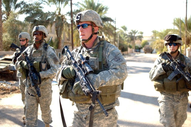 Soldiers from the 172nd Stryker Brigade Combat Team conduct a patrol in Mushada, Iraq, Nov. 17, 2006. Redesignated the 1st Stryker Brigade Combat Team, the Soldiers are back in Alaska and are busy training and resetting their equipment.